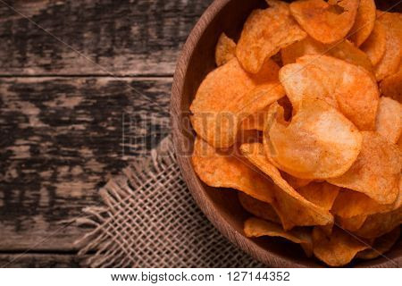Crispy Potato Chips In Bowl On Wooden Background