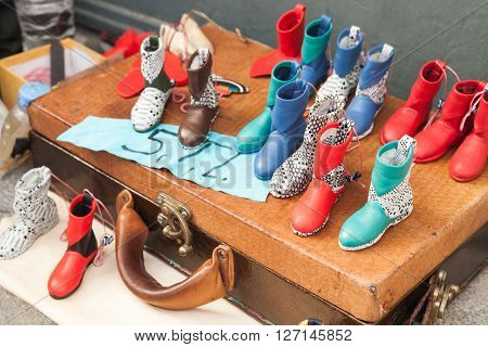 Izmir Turkey - February 5 2015: Traditional Turkish handmade souvenirs colorful boots made of genuine leather stand on old bag