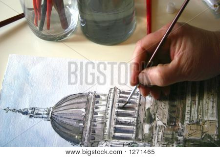 A Persons Hand Painting A Picture