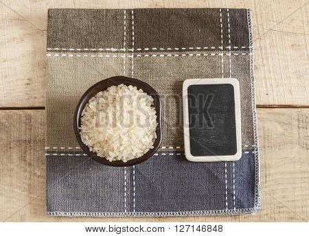 rice in  bowl on a wooden table background