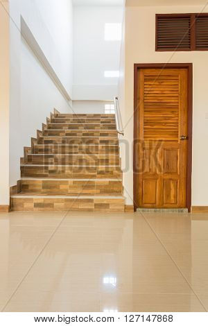 Staircase And Wood Door In Residential House