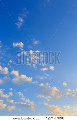Cloudy On Clear Blue Sky