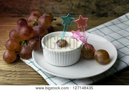 grape yoghurt on the wooden table, fruit, yogurt