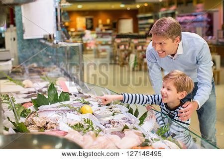 Dad and son in a fish store
