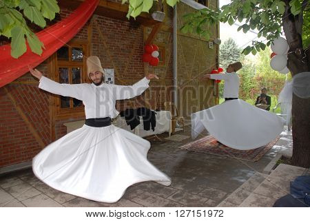 ANKARA/TURKEY-MAY 8, 2015: Sufi whirling dervish (Semazen) dances at the garden of YEKAD Association's cultural event. May 8, 2015-Ankara/Turkey