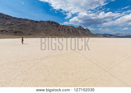 Girl walking in Racetrack in the Death Valley National Park