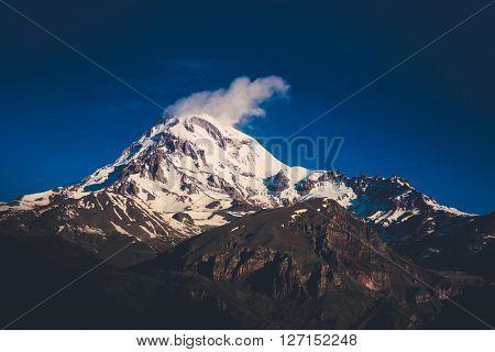 Snowy peak of mount Kazbek at dawn. Georgia