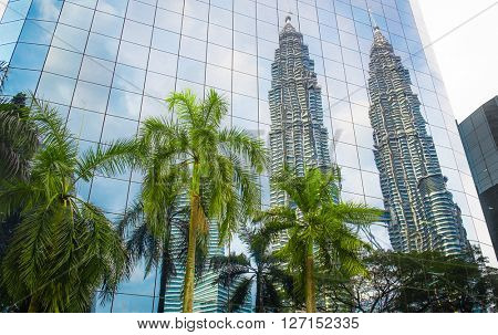 Modern blue glass building with reflection. Business centre in Kuala Lumpur