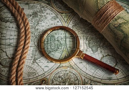 Vintage Magnifying Glass, Rope And Old Maps