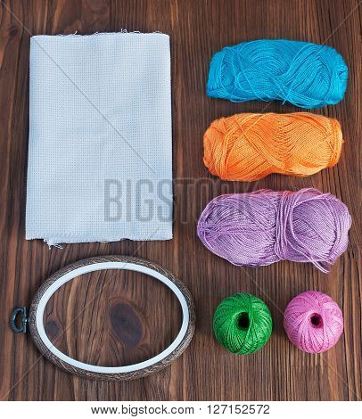 Tools for embroidery: colorful thread embroidery hoop and canvas