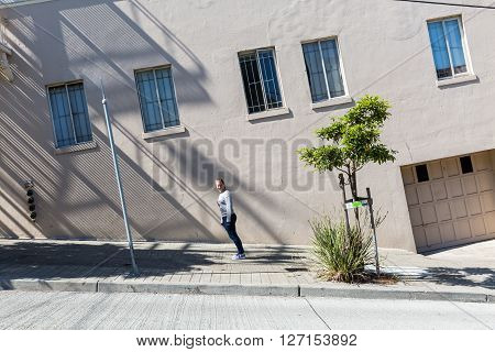 Girl standing on a steep road in San Francisco