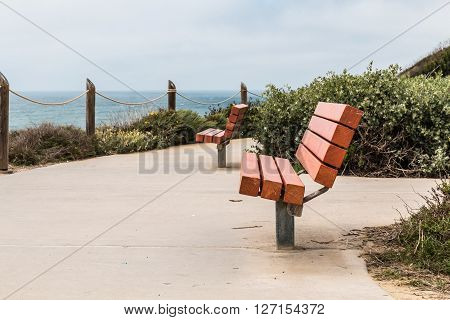 Two benches at an overlook of the ocean at the Point Loma tidepools in San Diego, California.