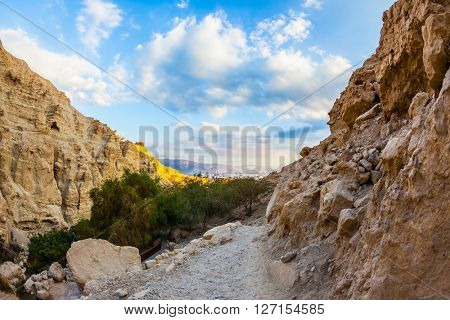 An exit from the gorge. Ancient mountains around the Dead Sea at sunset