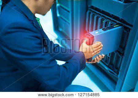 Man Fix Server Network In Data Center Room