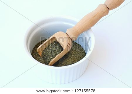 Dried Dill In The Bawl With The Ladle On The White Background