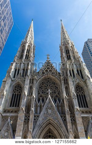 NEW YORK, USA - SEPTEMBER 19, 2015: View to the St. Patricks Cathedral in Midtown Manhattan with the famous 5th Avenue on SEPTEMBER 19, 2015. Its a decorated Neo-Gothic-style Roman Catholic cathedral church.