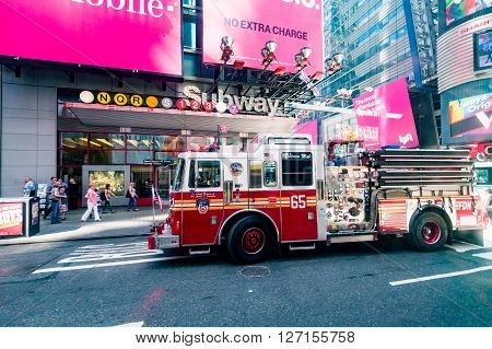 MANHATTAN NEW YORK - SEPTEMBER 19, 2015: View of a fire truck at the Times Square on September 19, 2015. The Fire Department of New York provides fire protection technical rescue and emergency services.