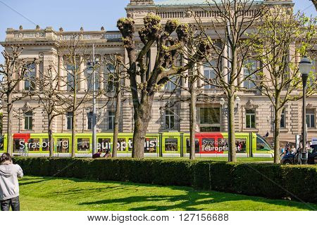 STRASBOURG FRANCE - APR 20 2016: Strasbourg Tramway in front of National Theatre of Strasbourg on a sunny day in Place de la Republique