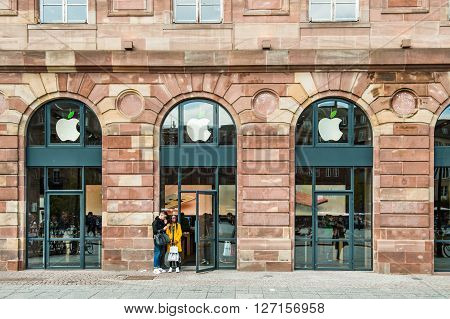 STRASBOURG FRANCE - APRIL 19 2016: Apple Store Strasbourg and Apple Stores around the world turn the leaf of the logo green in advance of Earth Day April 22