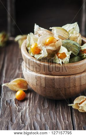Sweet Gooseberry On The Wooden Table