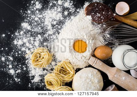 pasta homemade raw and ingredients for pasta. Flour, eggs, milk