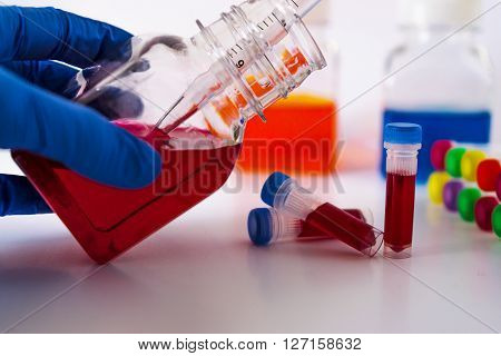 Laboratory pipette with test tube and color samples