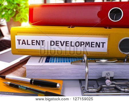 Yellow Office Folder with Inscription Talent Development on Office Desktop with Office Supplies and Modern Laptop. Talent Development Business Concept on Blurred Background. 3D Render.