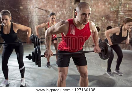 muscular bodybuilders have training with dumbbell