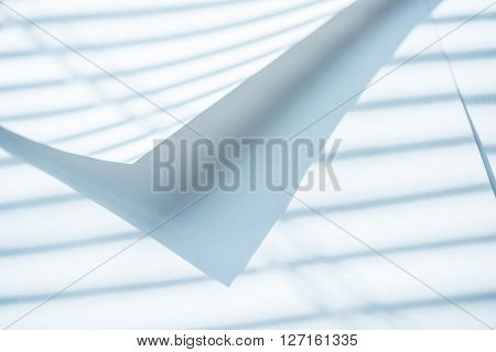 Paper sheets under shadow lines. Abstract background.