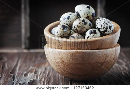 Uncooked Quail Eggs On The Wooden Table