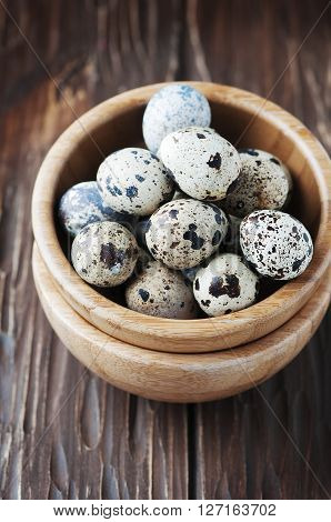 Uncooked Quail Eggs In The Wooden Bowl