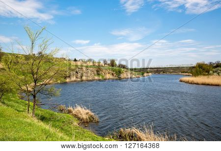 Landscape with rocks over river at spring day
