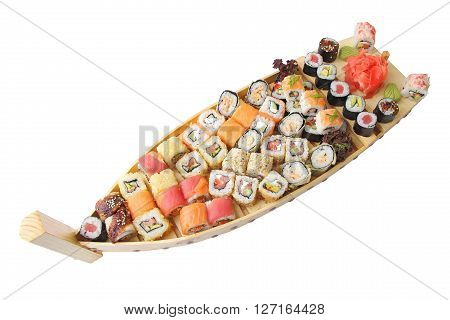 wooden ship with different kind of sushi and rolls isolated over white background.