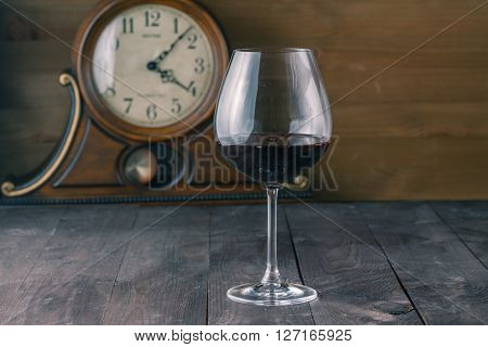 Glass Of Red Wine With Clock Background