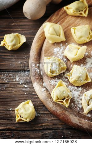 Homemade Italian Traditional Tortellini On The Wooden Table