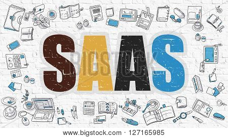 SaaS - Software as a Service. Multicolor Inscription on White Brick Wall with Doodle Icons Around. SaaS - Software as a Service - Concept. Modern Style Illustration with Doodle Design Icons.