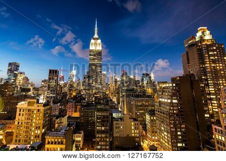 NEW YORK, USA - AUGUST 23, 2015: View to Midtown Manhattan with the famous Empire State Building at sunset on August 23 2015. This view is from the rooftop of the 230-fifth Bar.