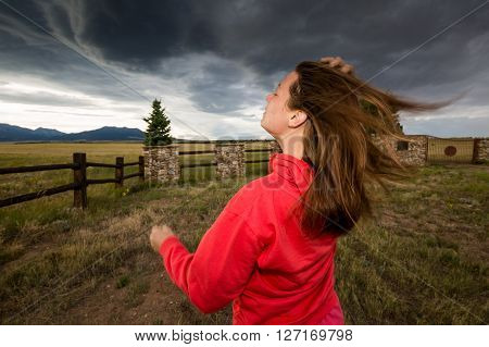 A Girl Standing Against The Wind