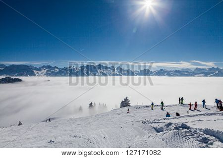 IBERGEREGG SCHWYZ SWITZERLAND - FEBRUARY 7, 2015: View from the hilltop of Mountain Ibergeregg on February 7 2015. Ibergeregg is a high mountain pass and ski resort in the swiss alps.