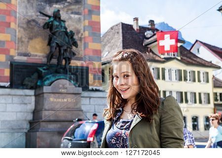 Young smiling girl in the village Altdorf ,Switzerland