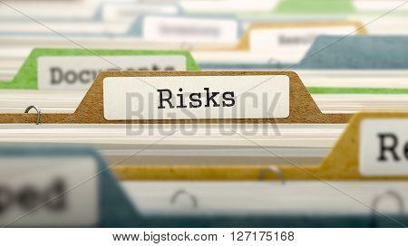 Risks Concept on File Label in Multicolor Card Index. Closeup View. Selective Focus. 3D Render.
