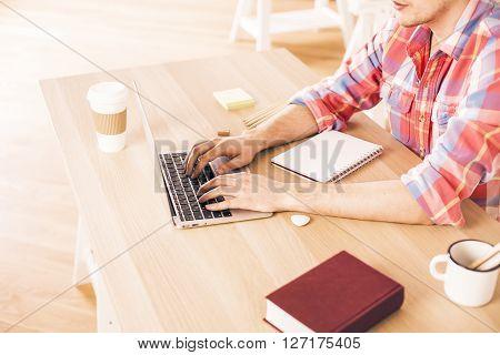Man Using Laptop Side