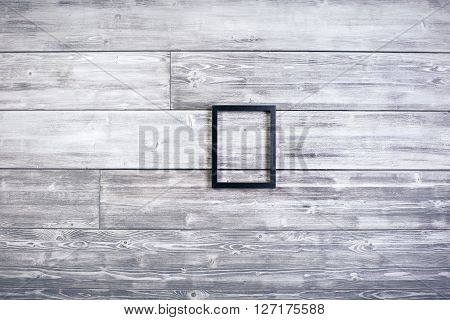 Black see-through frame on wooden background. Mock up