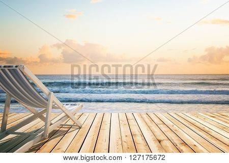 Chaise longue on wooden floor at the seaside. 3D Rendering