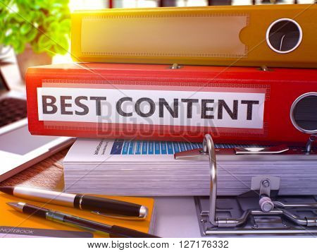 Red Office Folder with Inscription Best Content on Office Desktop with Office Supplies and Modern Laptop. Best Content Business Concept on Blurred Background. Best Content - Toned Image. 3D.