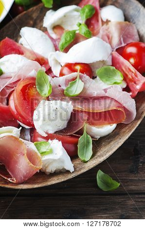 Italian Salad Caprese With Ham, Basil And Mozzarella