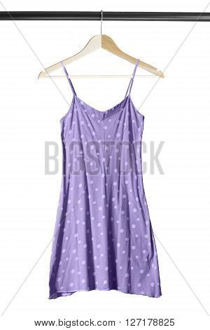 Purple cotton sundress on clothes rack isolated over white
