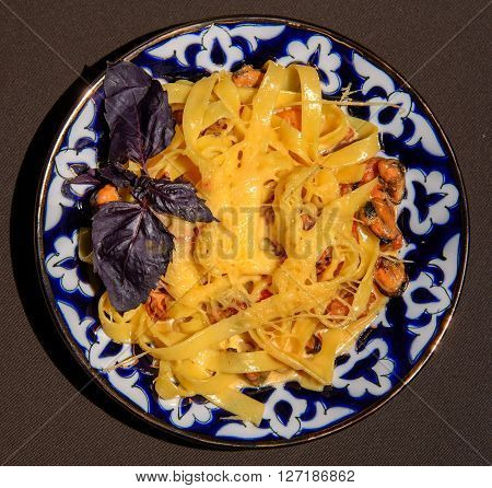 Gnocchi with tomato sauce with mussels italy