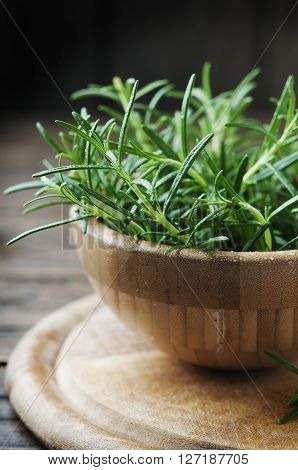 Fresh Green Rosemary In The Wooden Bowl