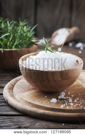 Sea Salt And Green Rosemary In The Wooden Bowl